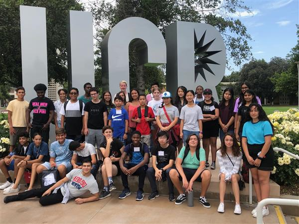 RUSD Students pose in front of iconic sign at UC Riverside
