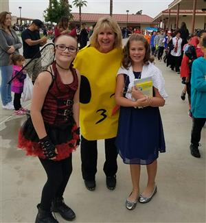 Principal Bamsch with Students at Harvest Festival
